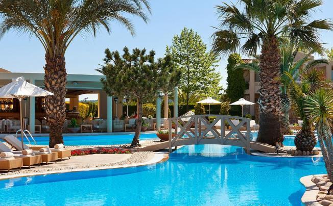 Отель Porto Sani Village & Spa