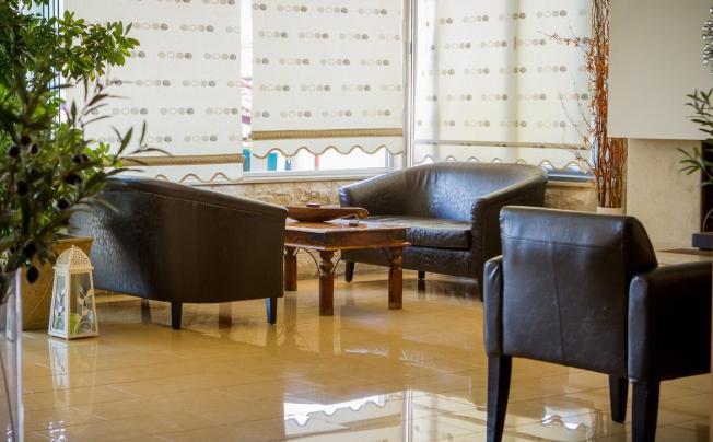 Отель Xenios Loutra Village Beach Hotel